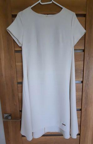 Biała sukienka zapinana na zamek z kieszonkami
