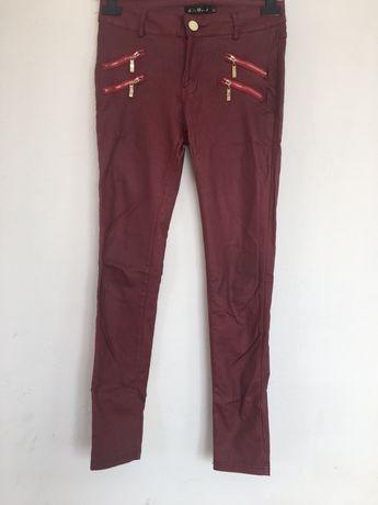 Damskie spodnie woskowane ze zlotymi zamkami rozmiar M