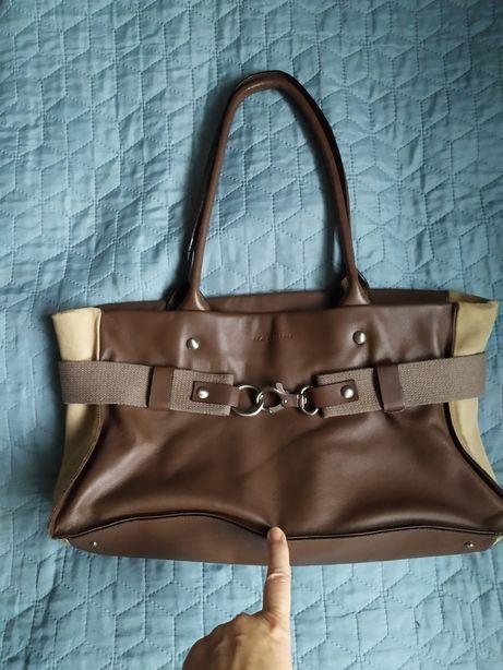 Поміняю коричневу шкіряну сумку