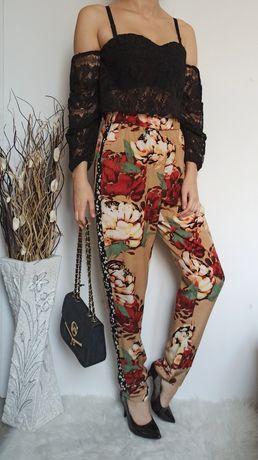 Świetne luźne spodnie w kwiaty lampasy L