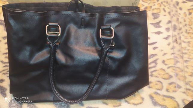 Жіноча сумочка..
