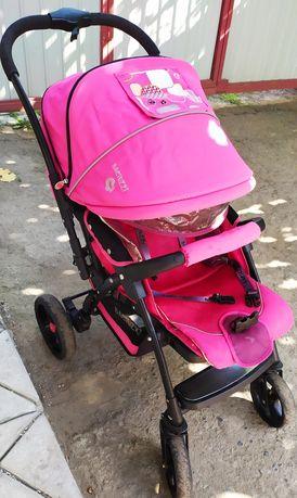 Продам детскую яркую коляску для девочки