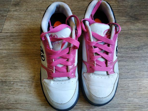 Продам кроссовки ролики heelys