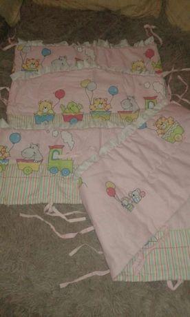 Захисні бортики у дитяче ліжечко