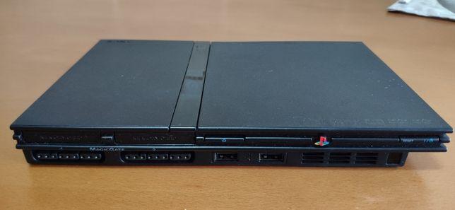 PlayStation 2 com jogos e comandos
