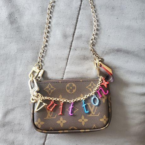Pingente para bolsa Louis Vuitton