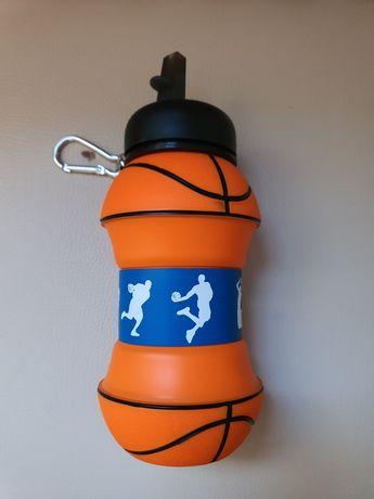 Vendo garrafa de água em forma de bola de basket