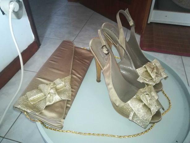 Conjunto mala e sandálias dourado