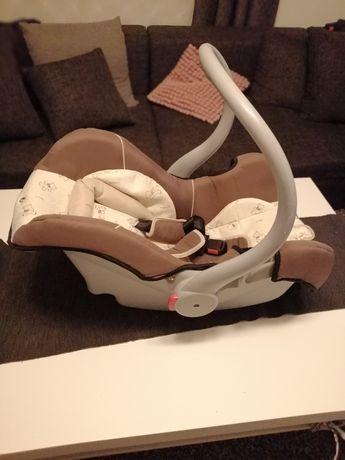 Fotelik nosidełko dla dziecka.