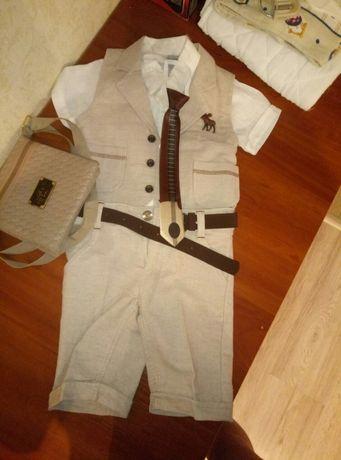 Костюм шортами праздничный на выход для мальчика с галстуком и сумкой