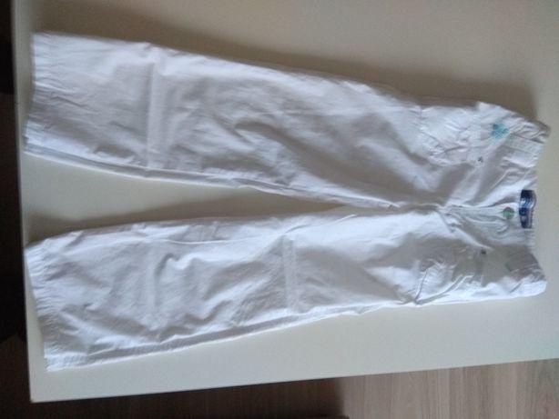 Piękne białe spodnie Reserved dla dziewczynki, rozmiar 116