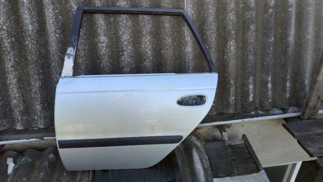 Дверь задняя левая Toyota Avensis Wagon T220 97-03