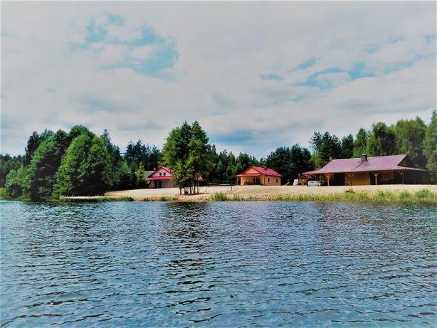 Domki nad prywatnym jeziorem z prywatną plażą-dostęp tylko dla wynajmu