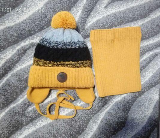 Продам детскую зимнюю шапку на 3.5-4 года