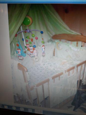 Кроватка детская деревянная с балдехином, матрасом и постельное белье.