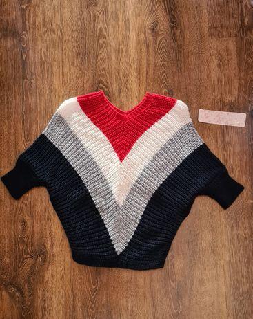 Nowy sweterek dziewczęcy