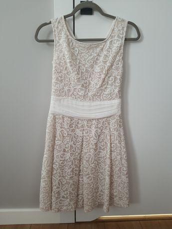 Piękna rozkloszowana sukienka ecru