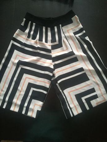 Modne spodnie szerokie krótkie