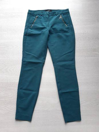 Stylowe spodnie rurki Mohito 32,XXS/34,XS zamki
