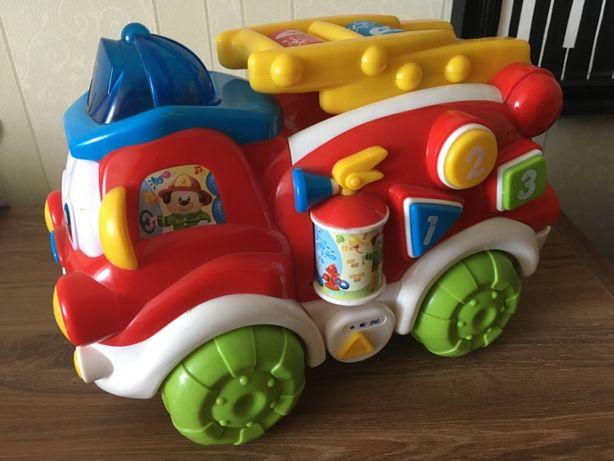 Машина пожарная игрушка музыкальная фирмы Baby Clementoni