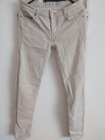Spodnie biodrówki kremowe