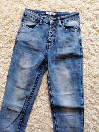 Jeansy damskie rozmiar 34 z guzikami