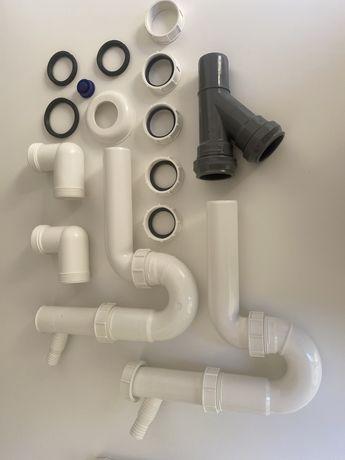 2 sifões de plástico e material de canalização