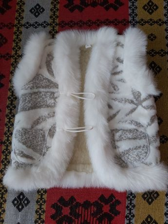 Теплая жилетка из шерсти