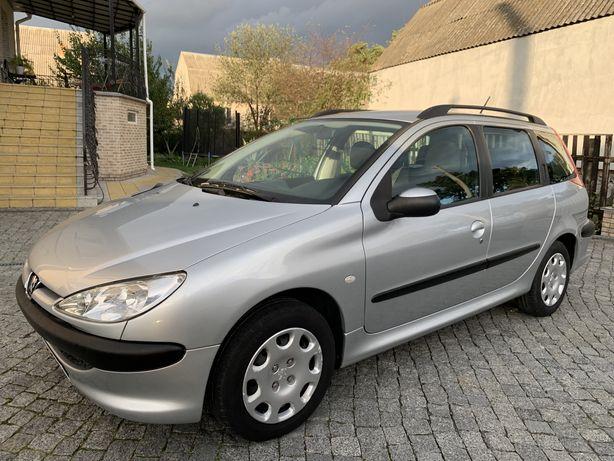 Peugeot.   206    SW