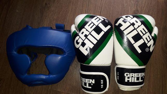 Перчатки боксерські + шолом.