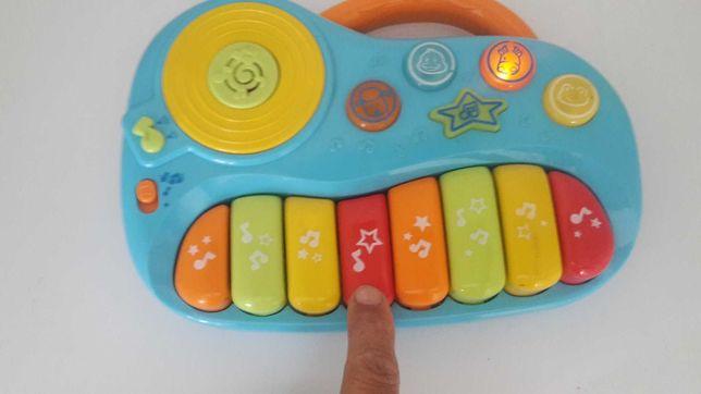 TECLADO PORTATIL Com Musicas Memorizadas. Com 8 Fotos