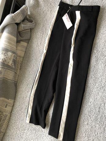 Штани(брюки) в полоску