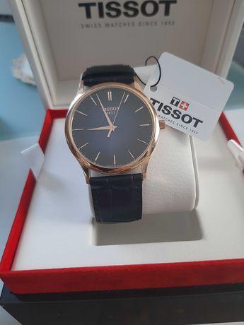 Vendo relógio Tissot em ouro novo e dentro da garantia com docomentos