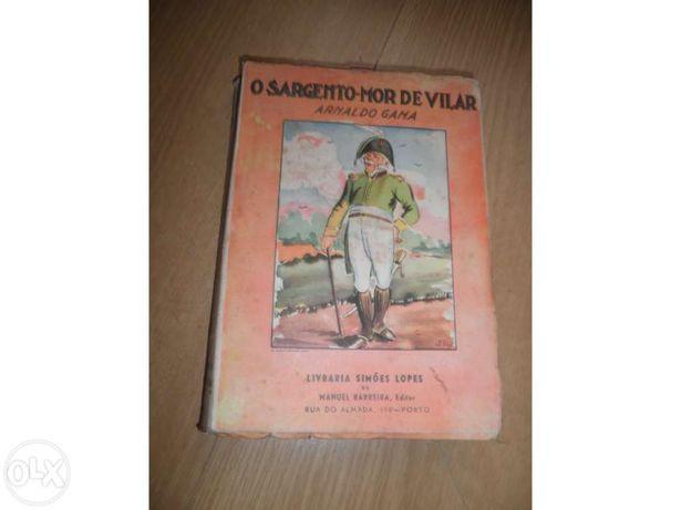Coleccionadores-alfarrabistas-2 livros com várias décadas