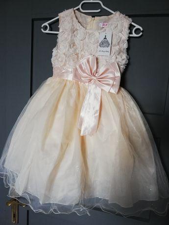 Śliczna sukieneczka jasna brzoskwinia