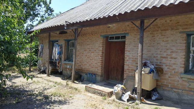 Продам домик в городе на земельном участке 24 сотки.