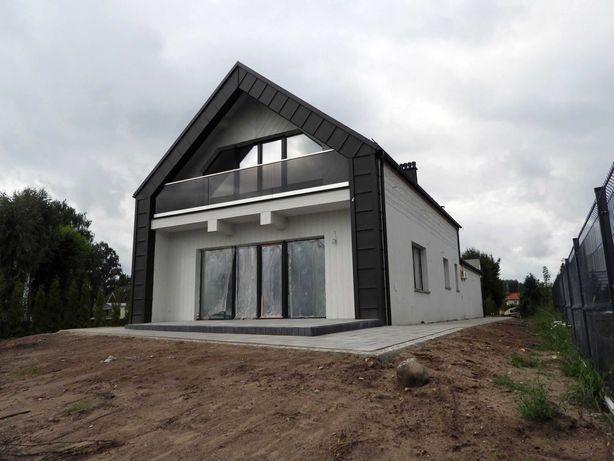 Dom nad jeziorem, na szlaku Wielkich Jezior Mazurskich