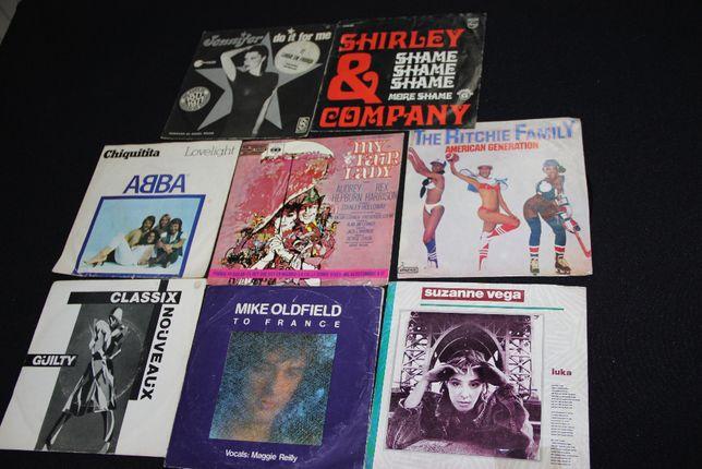 8 singles Abba,suzanne vega,mike oldfield