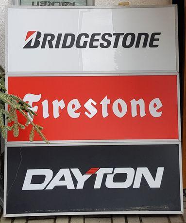 Podświetlana reklama producentów opon Firestone, Bridgestone, Dayton