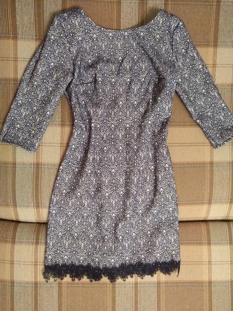 Коктейльное платье с вырезом на спинке