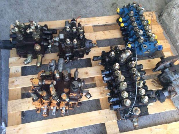 Distribuidores de hidraulico Retro Case,Komatsu,Fermec,JCB