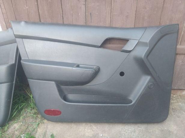Обшивка (карты) дверей Chevrolet Aveo
