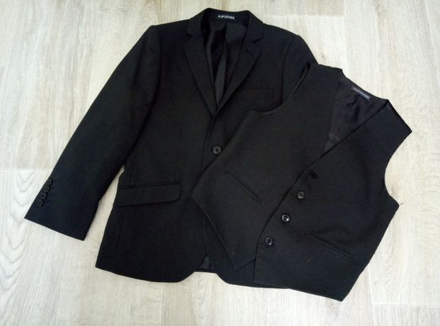 Новый школьный пиджак+жилетка на рост 134-146 см.