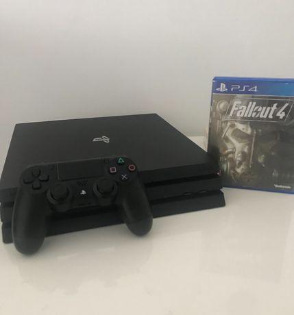 Konsola PS4 pro z kontrolerem i grą fallout 4