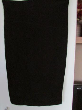 Ołówkowa spódnica midi z efektownym rozporkiem 38