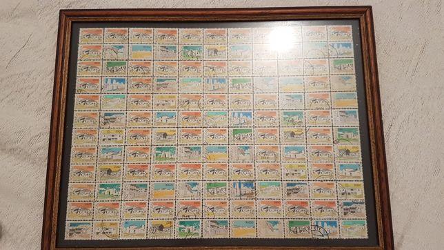 Selos emoldurados em quadro