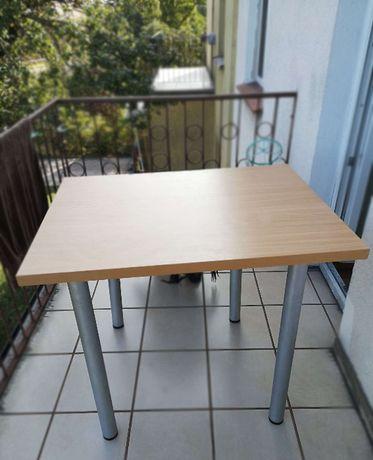 Stół / blat (buk) z regulowaną wysokością.