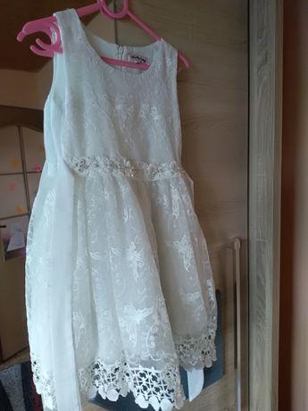 Sprzedam ubranka na dziewczynkę 122-128.