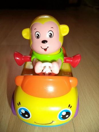 zabawka - samochodzik na resorach z uśmiechniętą małpką