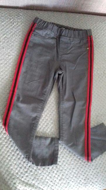 Spodnie reserved rozm.116